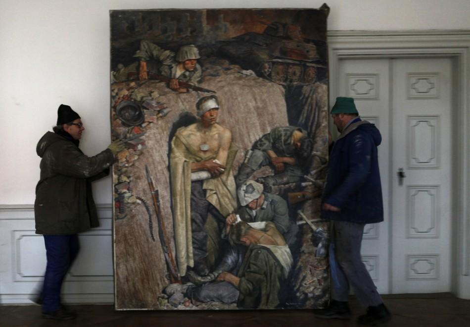 Workers move a 1943 painting by German painter Eichhorst at the Doksany Monastery near Prague