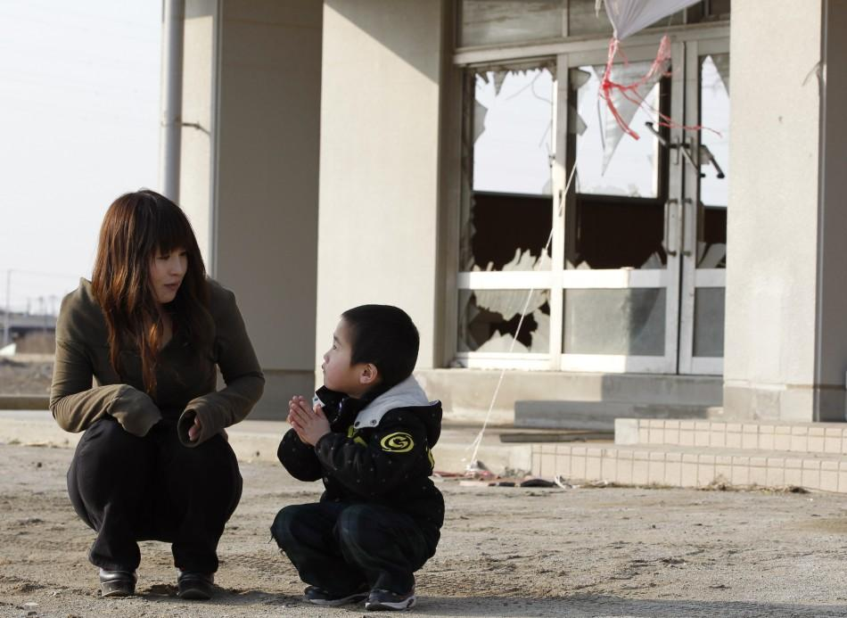 Woman from Iconic Tsunami Photo Reunited With Family Stares at Future