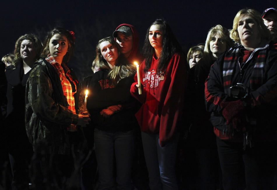 People gather outside St. Mary's of Chardon for a candlelight vigil remembering the victims of a school shooting in Chardon, Ohio