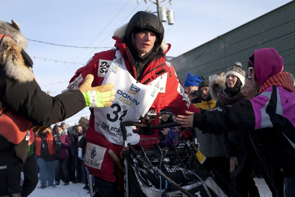 Musher Seavey runs his dogs to the finish line, winning the 40th annual Iditarod Trail Sled Dog Race in Nome, Alaska