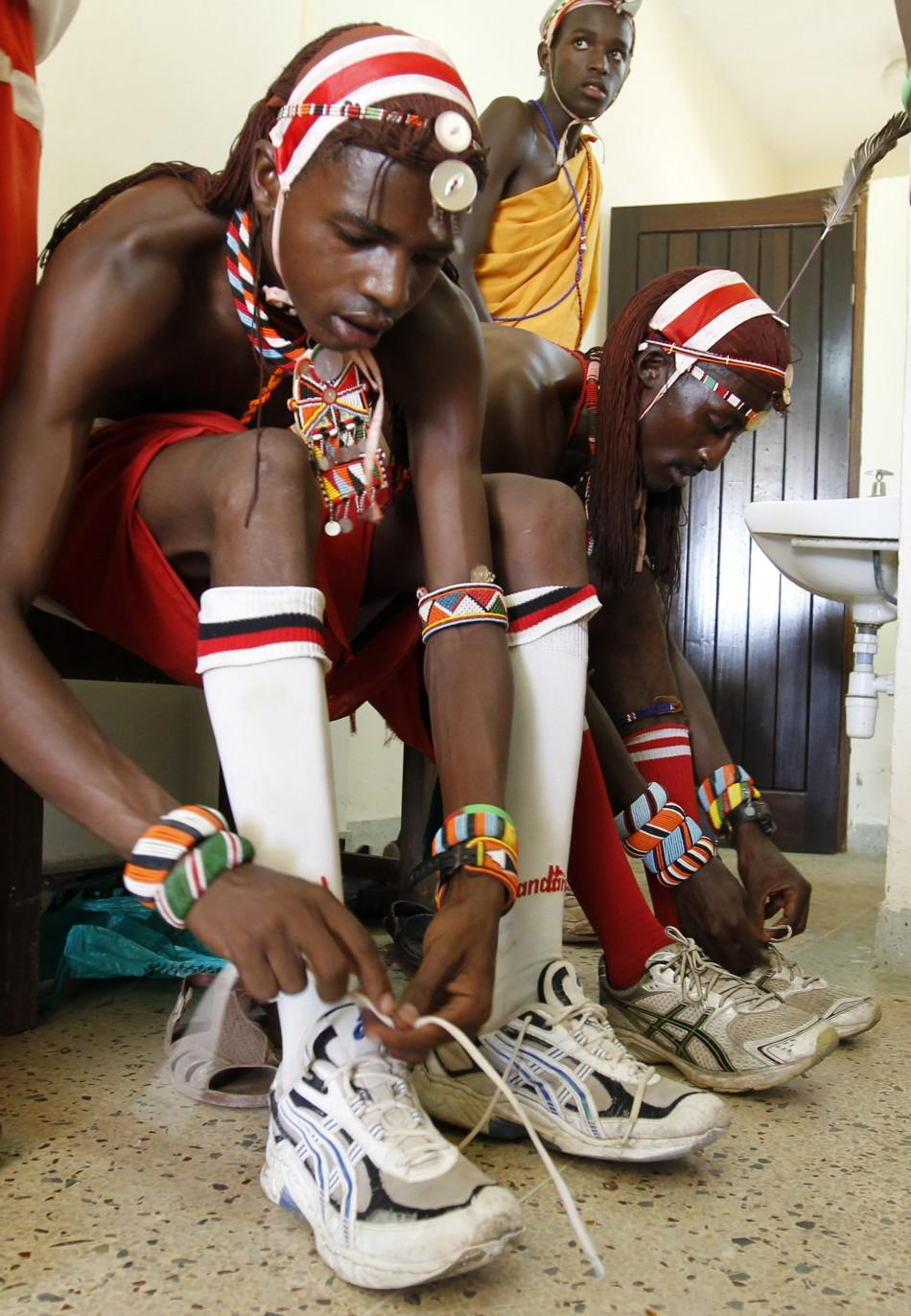 Members of the Maasai Cricket Warriors prepare for their friendly match against the Jafferys team in the Kenyan coastal city of Mombasa