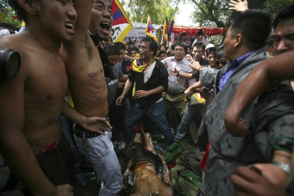 Tibetan exiles shout slogans during the anti-China protest in New Delhi.