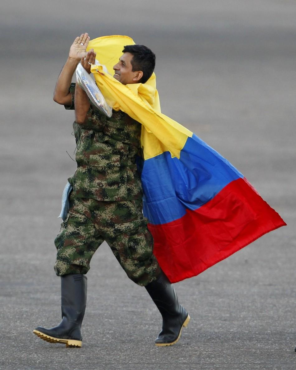 A soldier held hostage by FARC rebels celebrates as he arrives at Villavicencio's airport after being freed