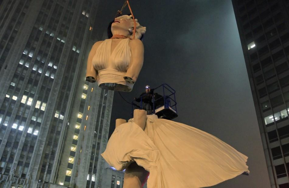 A 26-foot tall statue of Marilyn Monroe is separated for disassembly in Chicago