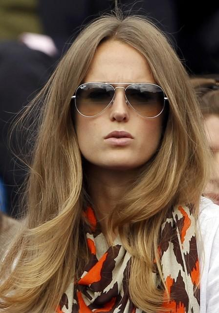 Kim Sears watches the match between Murray and Nicolas Mahut during their match at the Queen's Club tournament in London