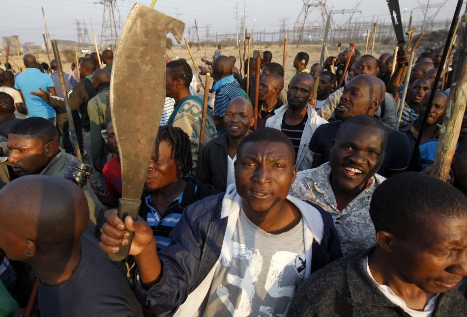 Protesters striking at a platinum mine in South Africa Thursday. Many in the crowd were armed.