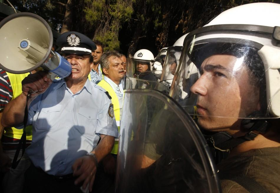 On-duty Greek riot police clashed with a small contingent of colleagues on strike Thursday, in an event that put an emotional climax to a week of protest in Greece.