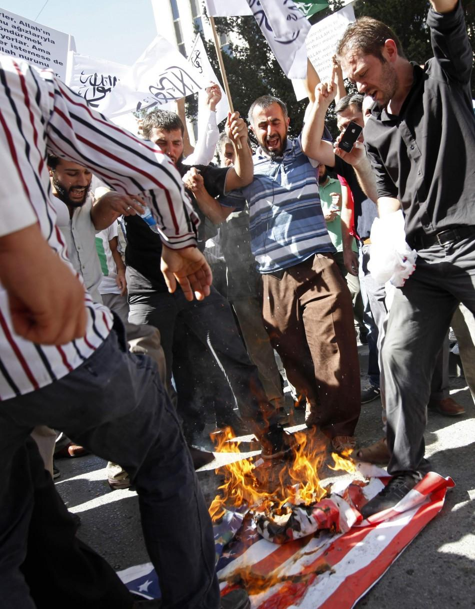 Muslim protesters, who have taken issue with the depiction afforded the Prophet Muhammad in an American film, burn the U.S. flag in Ankara, Turkey.