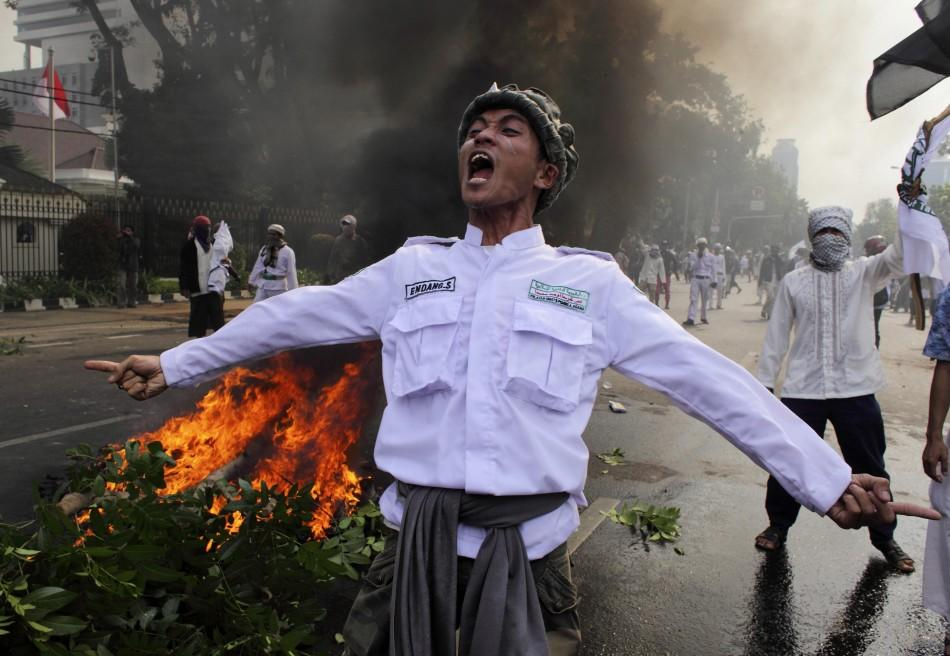 Muslim protesters in Jakarta, Indonesia faced off with police officers during an anti-U.S. protest there Monday.
