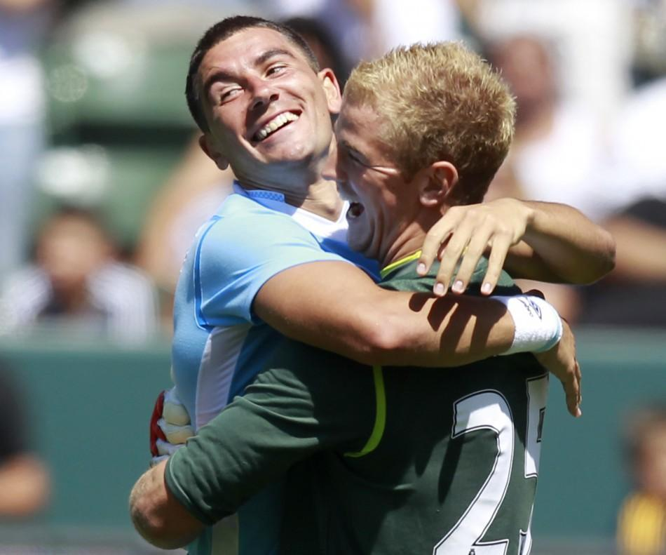 Manchester City's goalkeeper Joe Hart (R) celebrates with Aleksandar Kolarov after scoring the final penalty kick to win their World Football Challenge soccer match against Los Angeles Galaxy in Carson, California