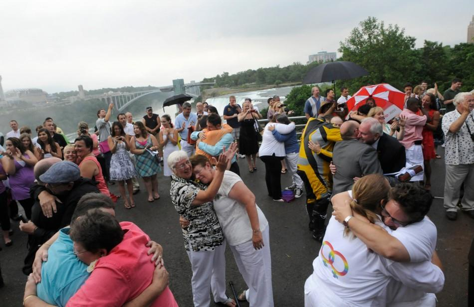Forty six couples are wed in a large same-sex ceremony, near the brink of Niagara Falls, in Niagara Falls