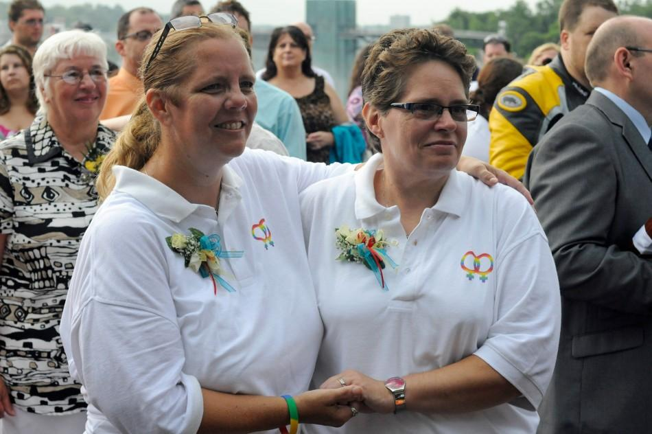 Nancy and Sharon Gerbracht are among forty six couples wed in a large same-sex ceremony, near the brink of Niagara Falls, in Niagara Falls
