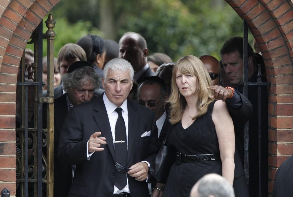 Mitch Winehouse, the father of British singer Amy Winehouse, leaves after her cremation at Golders Green Crematorium in north London