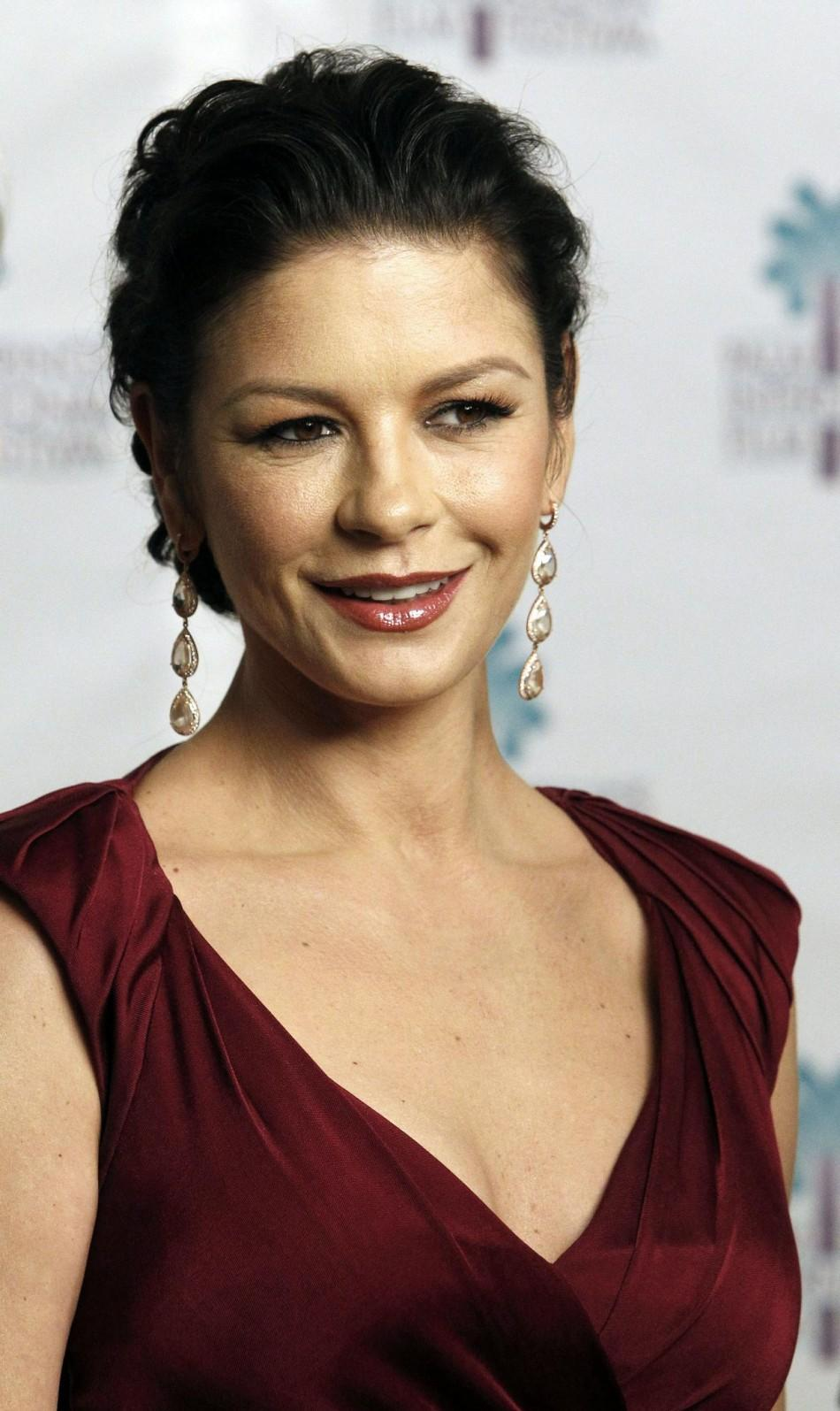 Actress Catherine Zeta-Jones smiles as she arrives for her husband Michael Douglas to receive the Icon Award at the 22nd Annual Palm Springs International Film Festival Gala.