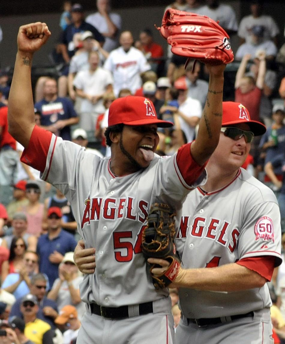 Los Angeles Angels pitcher Ervin Santana (L) celebrates with first baseman Mark Trumbo (R) after throwing a no hitter during the Angels MLB American League baseball game against the Cleveland Indians in Cleveland, Ohio