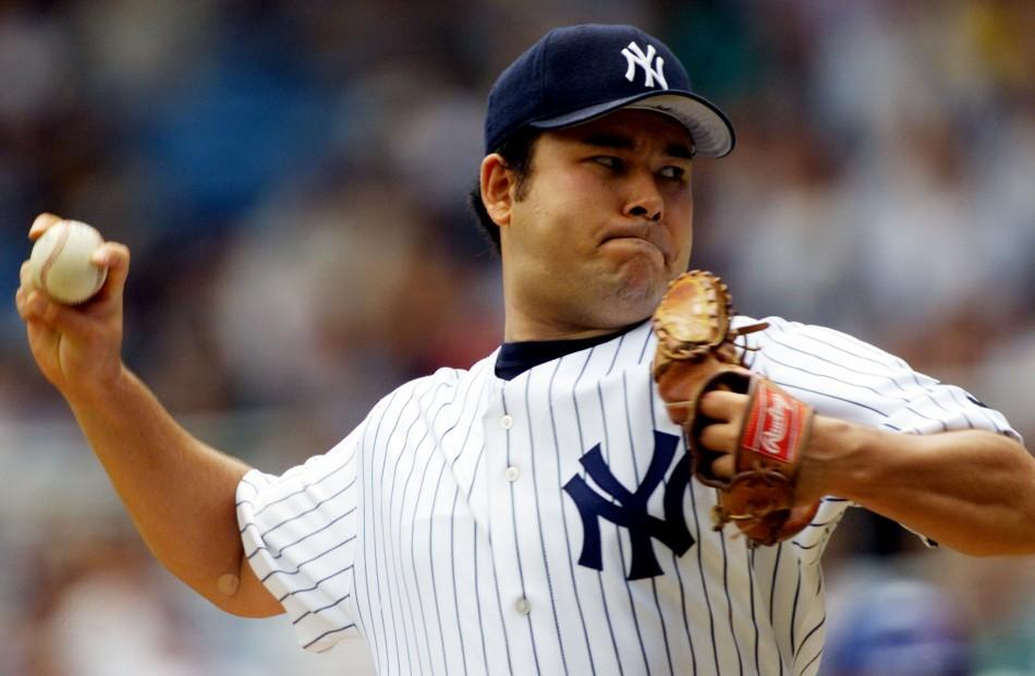 New York Yankees starting pitcher Hideki Irabu throws against the Toronto Blue Jays in the first inning of their game at New York's Yankee Stadium, August 4. Irabu entered the game with a record of eight wins and three losses and an earned run averag