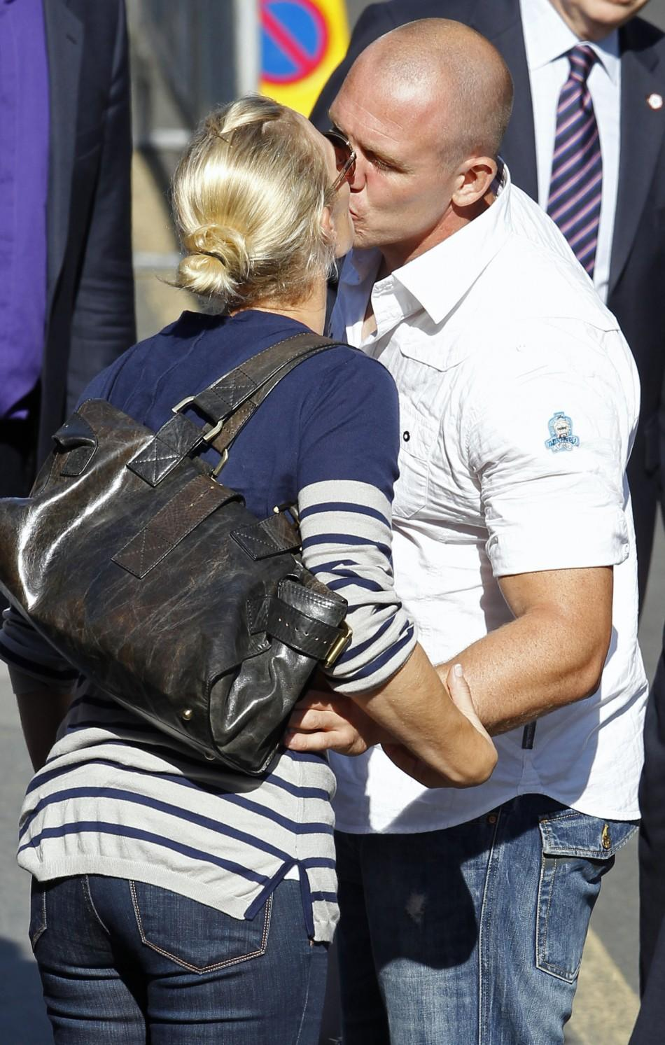 Britain's Zara Phillips, the eldest granddaughter of Queen Elizabeth, and England rugby captain Mike Tindall, kiss after their wedding rehearsal at Canongate Kirk in Edinburgh, Scotland
