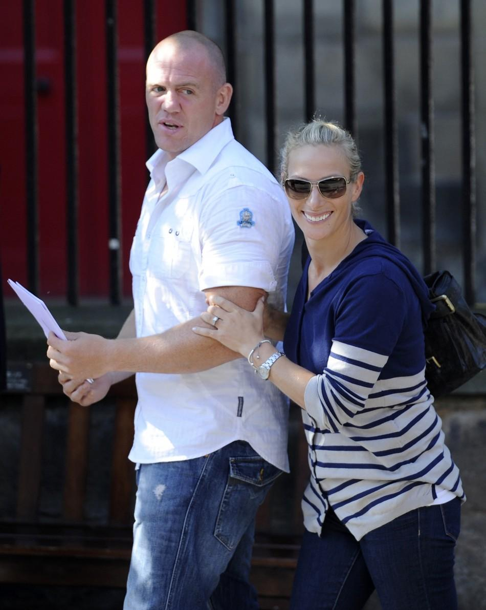 Britain's Zara Phillips (R), the eldest granddaughter of Queen Elizabeth and England rugby captain Mike Tindall (L) leave after their wedding rehearsal, at Canongate Kirk in Edinburgh, Scotland