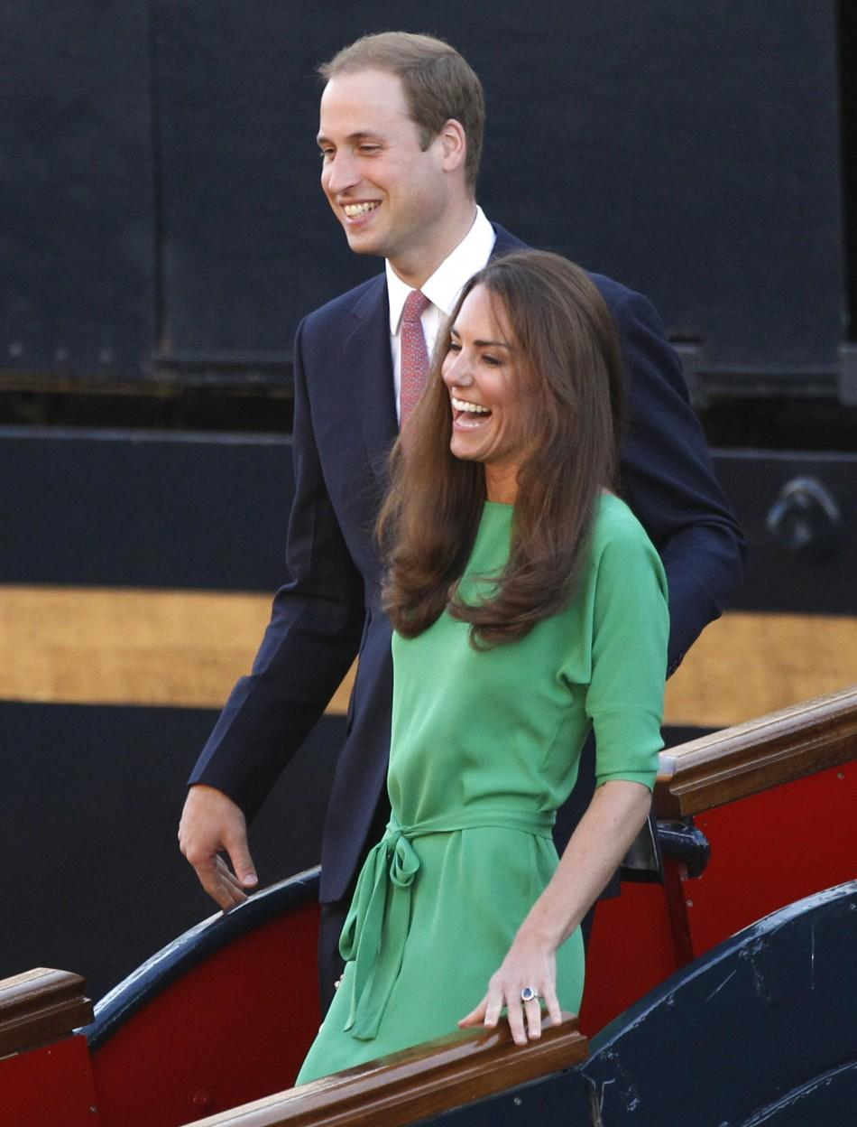Prince William and his wife Catherine, the Duchess of Cambridge, laugh as they leave a drinks reception on the royal yacht Brittania in Edinburgh