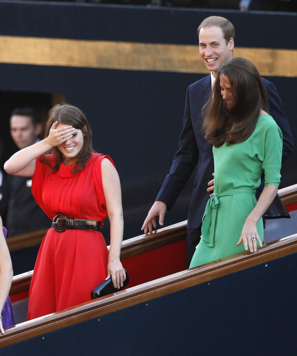 Britain's Princess Eugenie gestures as she, Prince William and his wife Catherine, Duchess of Cambridge leave drinks reception on royal yacht Brittania in Edinburgh