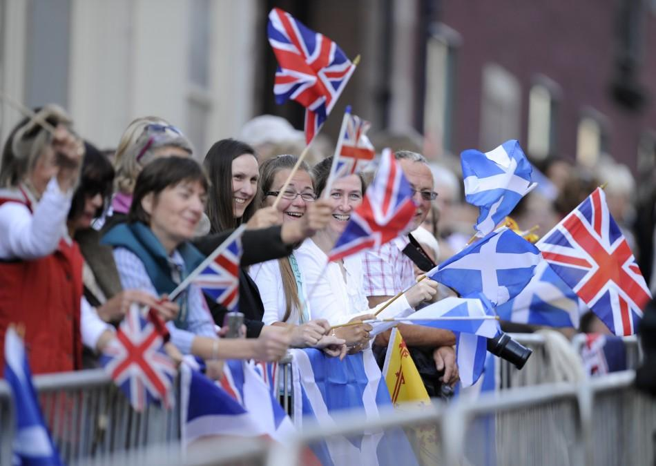 (PHOTOS) Zara Phillips-Mike Tindall Royal Wedding: Spectators Gather with Flags in Edinburgh.
