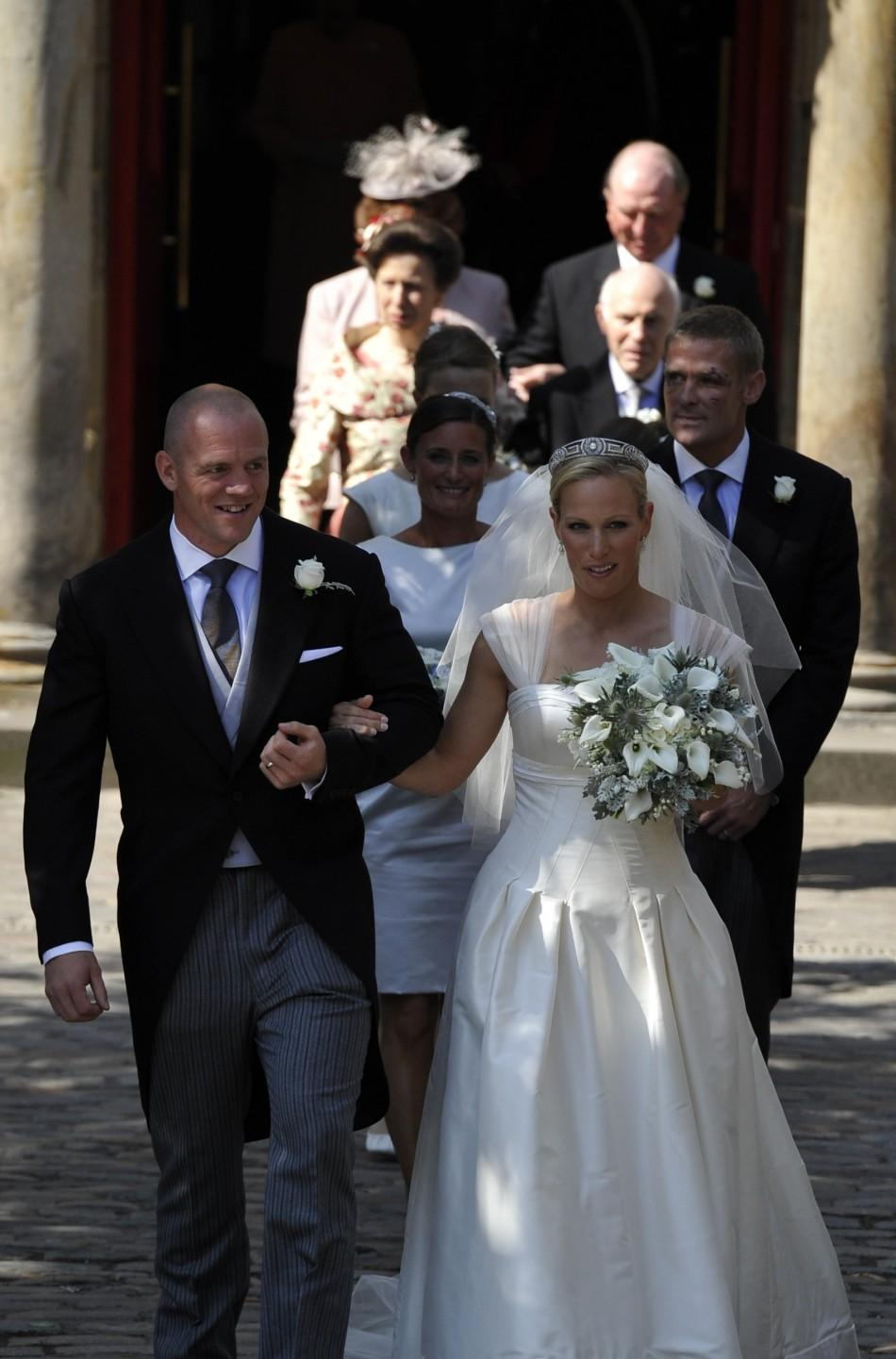 Britain's Zara Phillips and her husband England rugby captain Mike Tindall leave the church after their marriage at Canongate Kirk in Edinburgh
