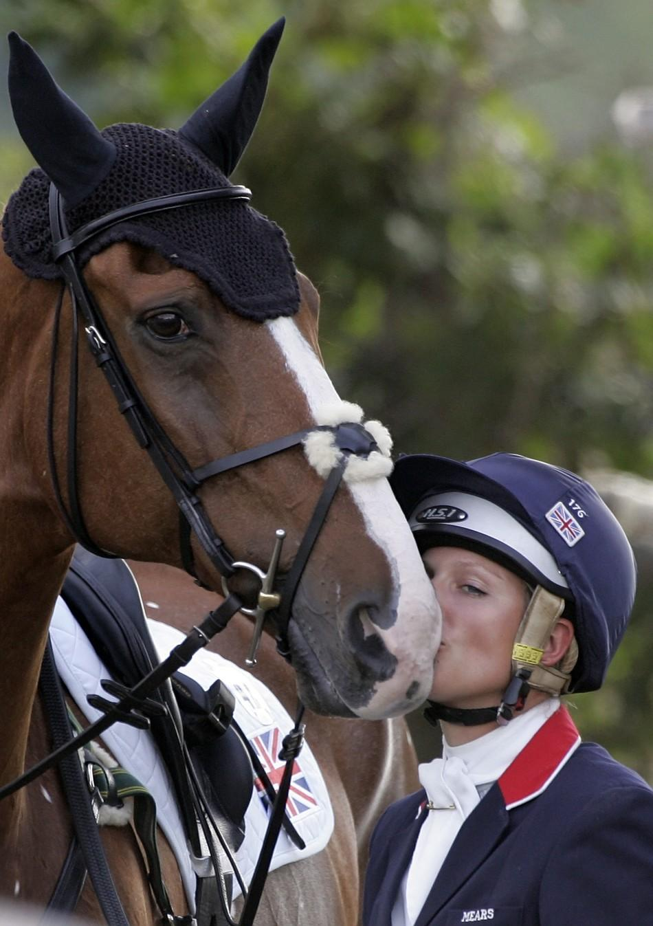Zara Phillips, granddaughter of Queen Elizabeth, kisses her horse Toytown before her performance in the Jump starters during the European Equestrian Championship at the Pratoni Del Vivaro in southern Rome
