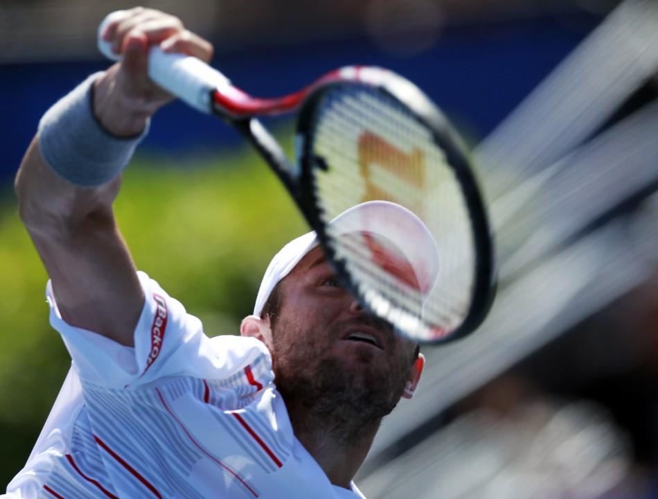 Mardy Fish of the U.S. serves to compatriot Ryan Harrison during the semi-finals of the ATP Los Angeles International tennis open tournament in Los Angeles