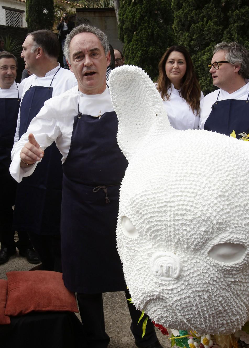 Ferran Adria, chef and co-owner of El Bulli restaurant, gestures during a news conference outside the restaurant in Cala Montjoi, near Roses.
