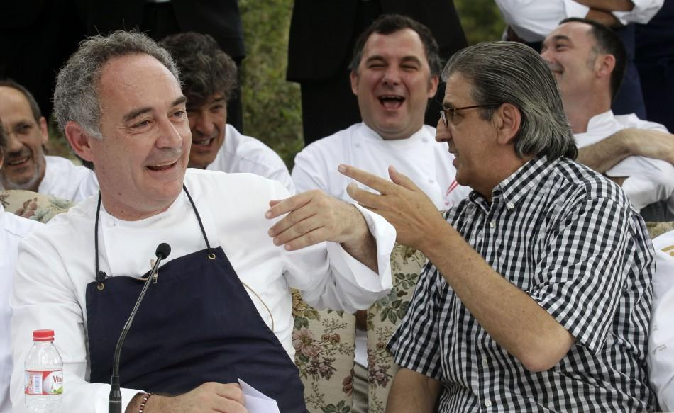 Ferran Adria, chef and co-owner of El Bulli restaurant, jokes with co-owner Juli Soler during a news conference in Cala Montjoi, near Roses.