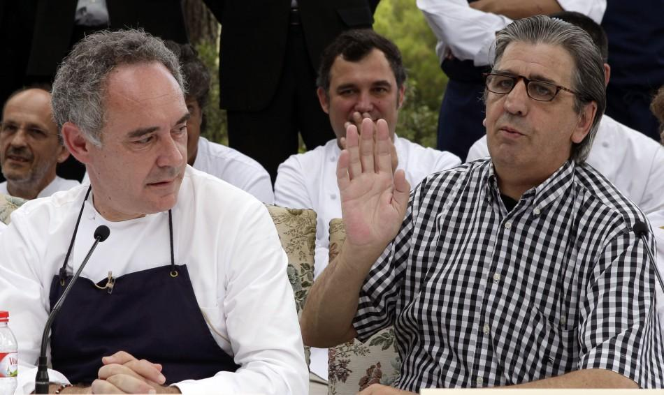 Ferran Adria (L), chef and co-owner of El Bulli restaurant, sits next to co-owner Juli Soler during a news conference in Cala Montjoi, near Roses.