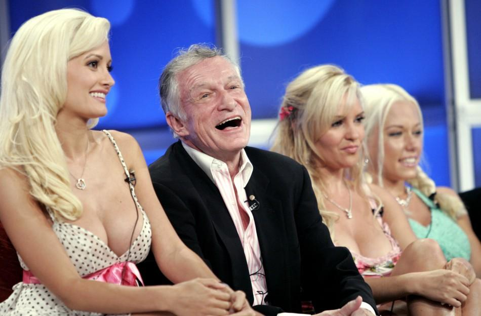 Playboy founder Hugh Hefner (2nd L), surrounded by his three girlfriends