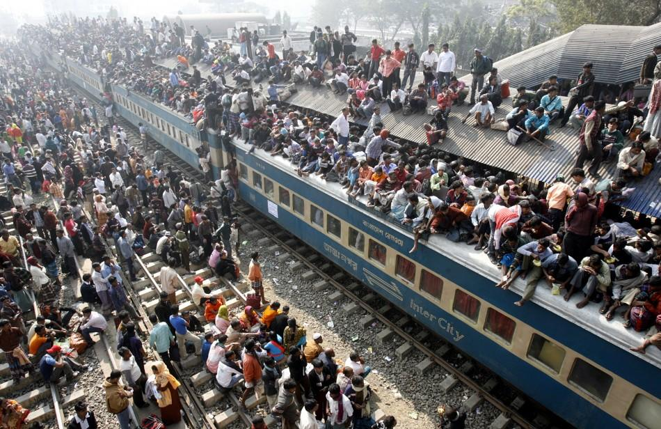 People try to board a crowded passenger train to take part in the Nat, or spirits, festival, at Taungbyone station