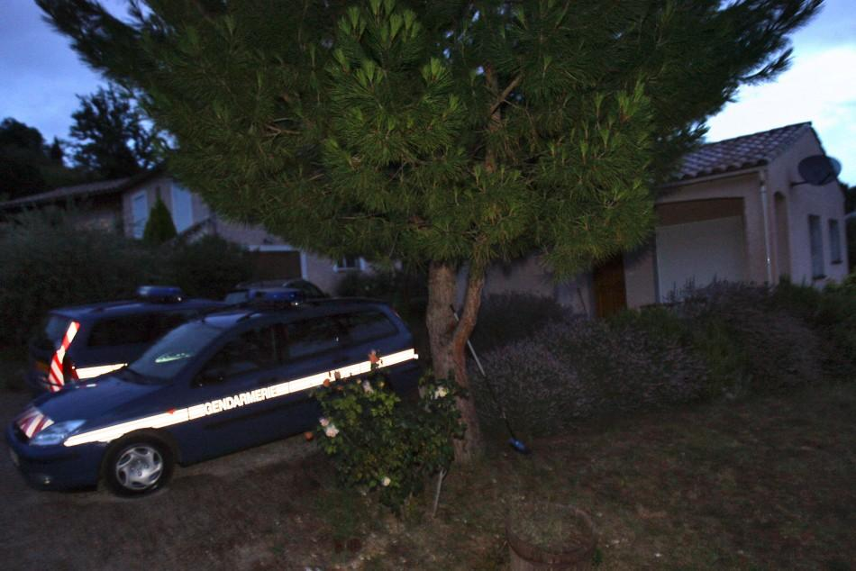 Cars of French gendarmes stand in front of the house of Jens Breivik, the father of Anders Behring Breivik, in Cournanel, southern France