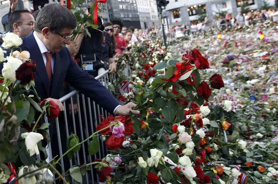Turkey's Foreign Minister Ahmet Davutoglu lays flowers outside the Oslo cathedral