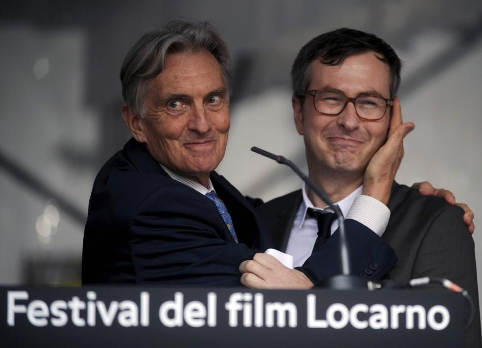 Film Festival President Marco Solari (L) jokes with Director Olivier Pere on the Piazza Grande during the opening of the 64th Locarno Film Festival