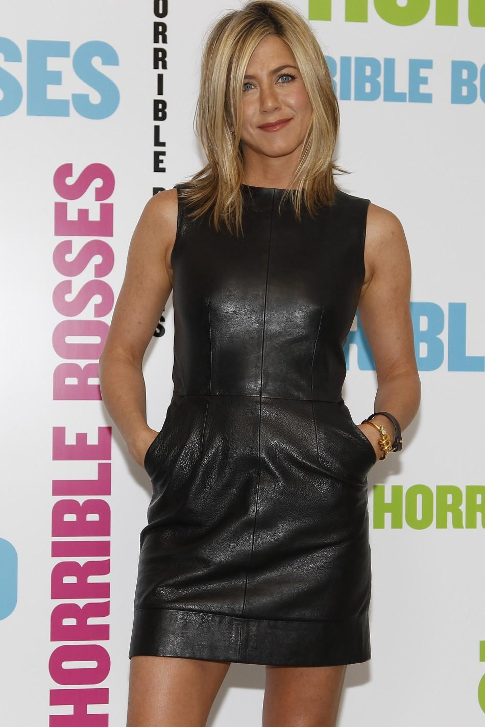 "Actress Jennifer Aniston poses during a media event to promote her latest movie ""Horrible Bosses"", at a hotel in London"
