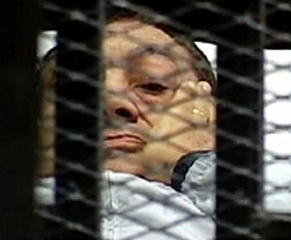 Hosni Mubarak is seen in the courtroom for his trial at the Police Academy in Cairo in this still image taken from video