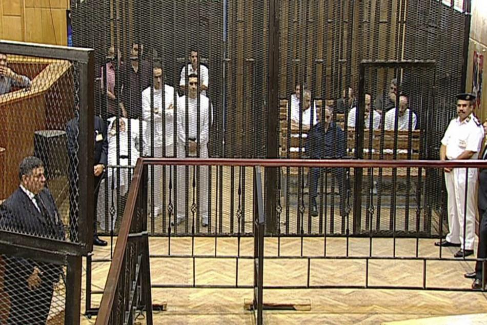 Defendants including Egypt's former president Mubarak, his two sons Gamal and Alaa Mubarak, and former interior minister al-Adli attend their trial in Cairo