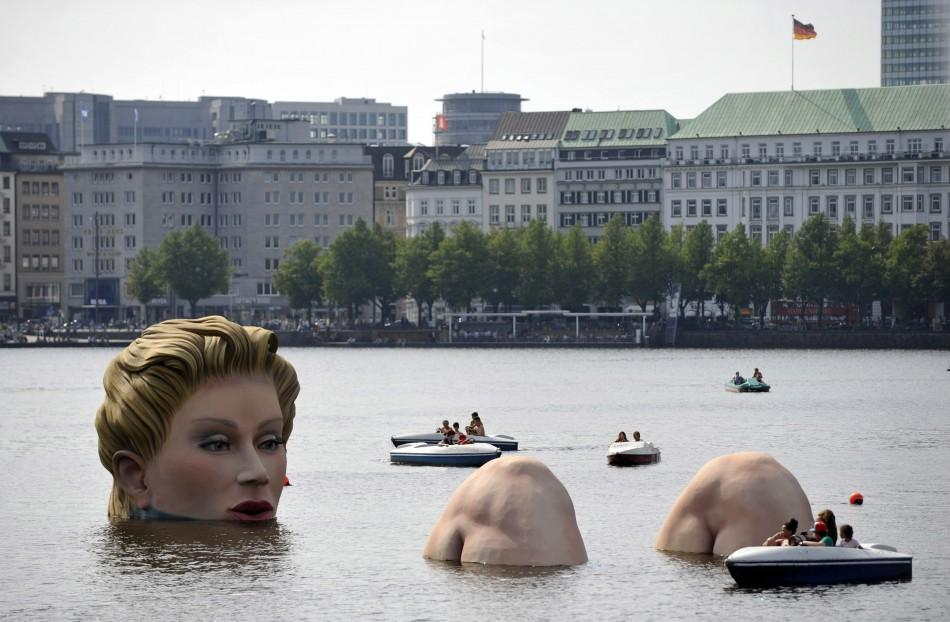 Boats gather around a sculpture of a mermaid at the 'Alster' lake in Hamburg
