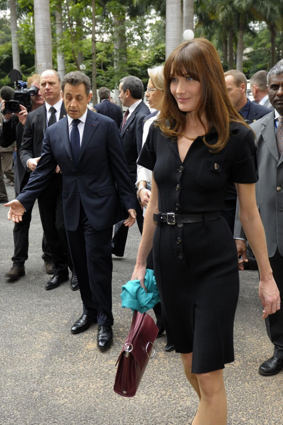 France's President Sarkozy and First Lady Carla Bruni-Sarkozy leave a meeting at the ISRO satellite center in Bangalore