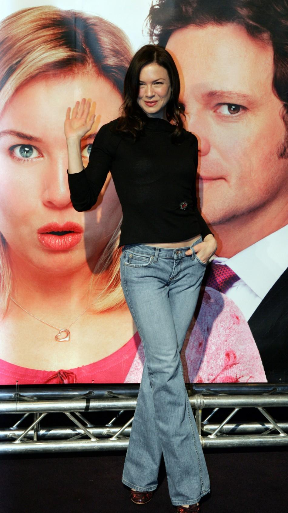 Renee Zellweger poses in front of a poster for 'Bridget Jones - The Edge of Reason'