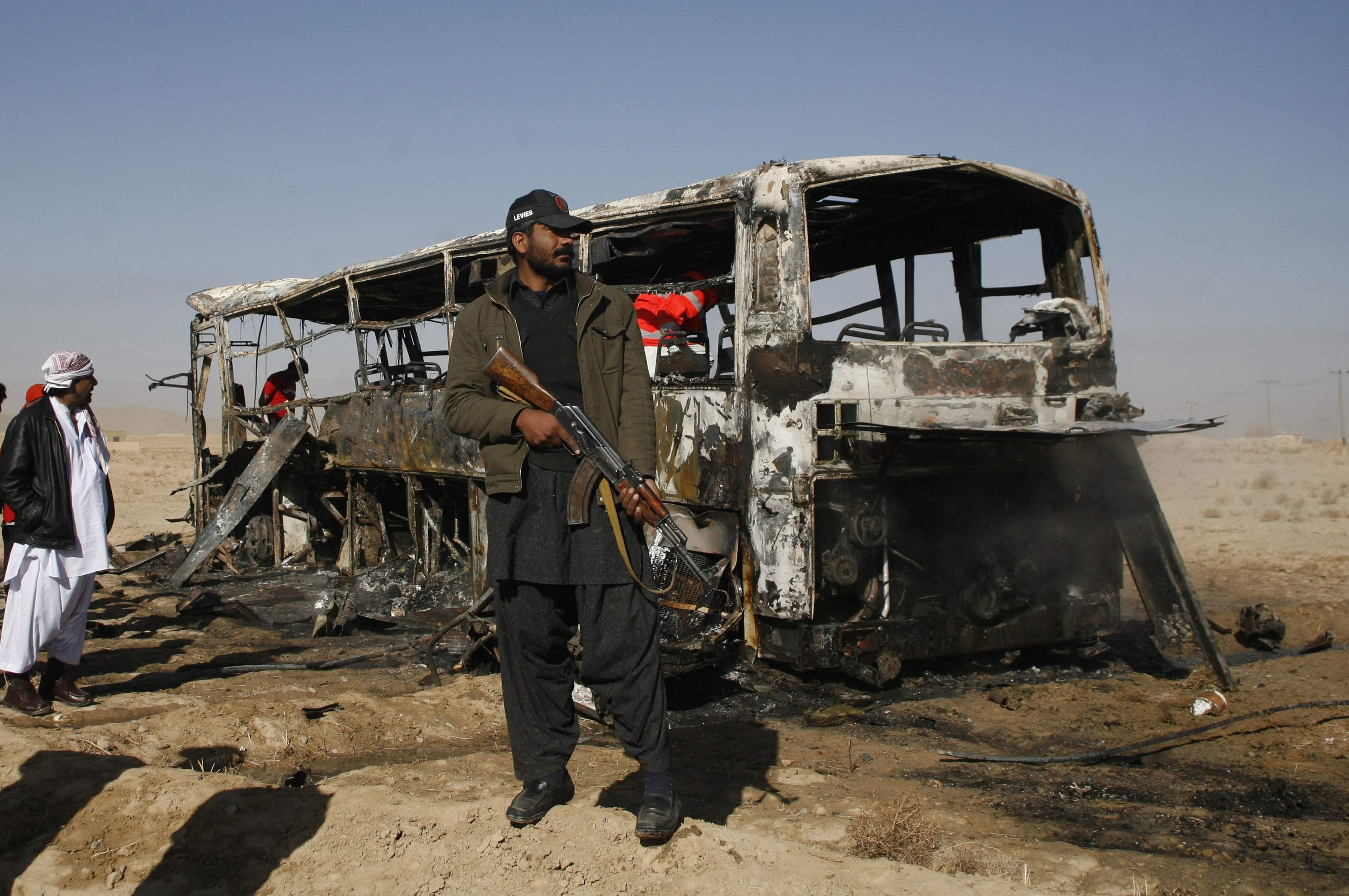 Paramilitary soldier stands guard at the site of a bomb explosion in Quetta