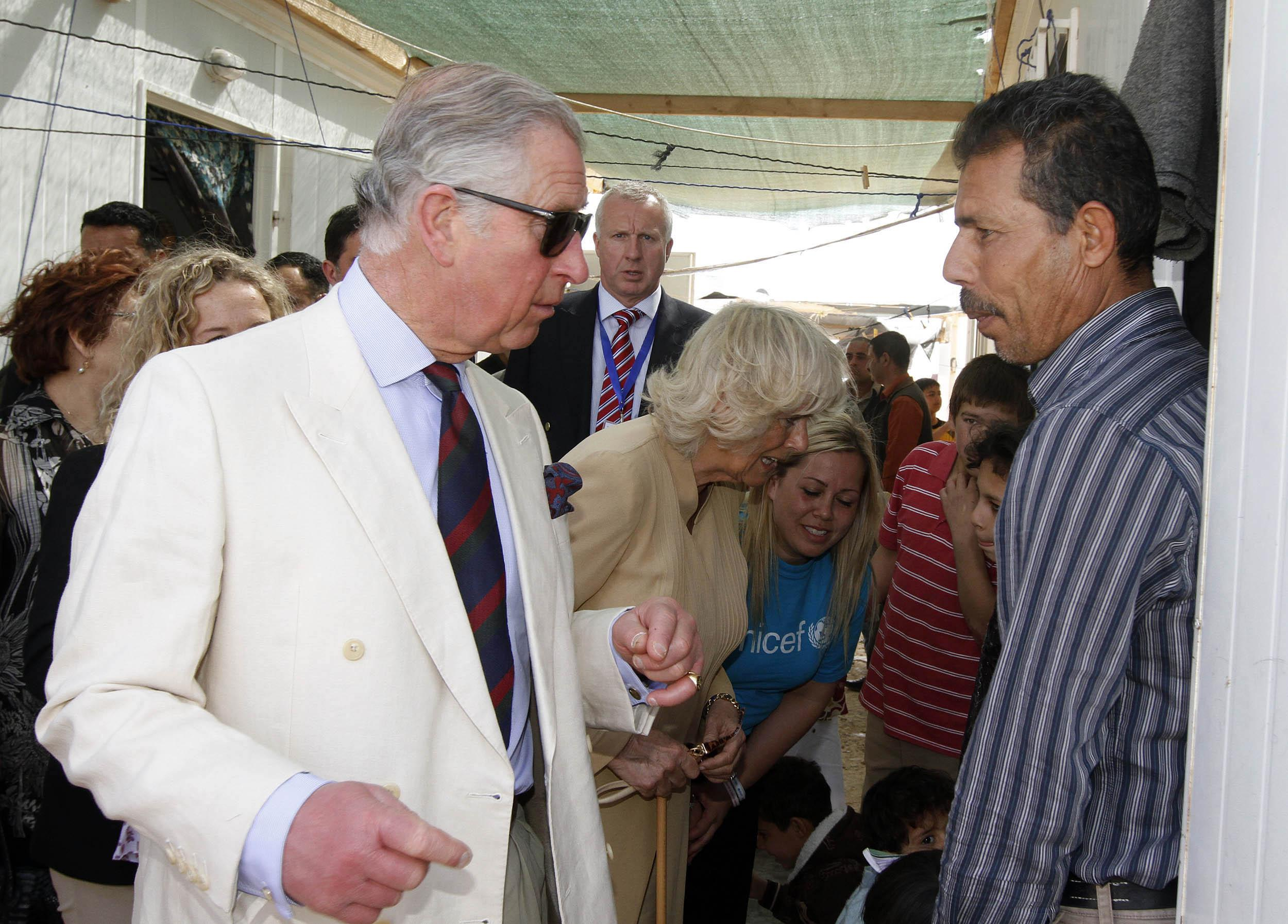 Prince Charles talks with a Syrian refugee in a Jordan Camp