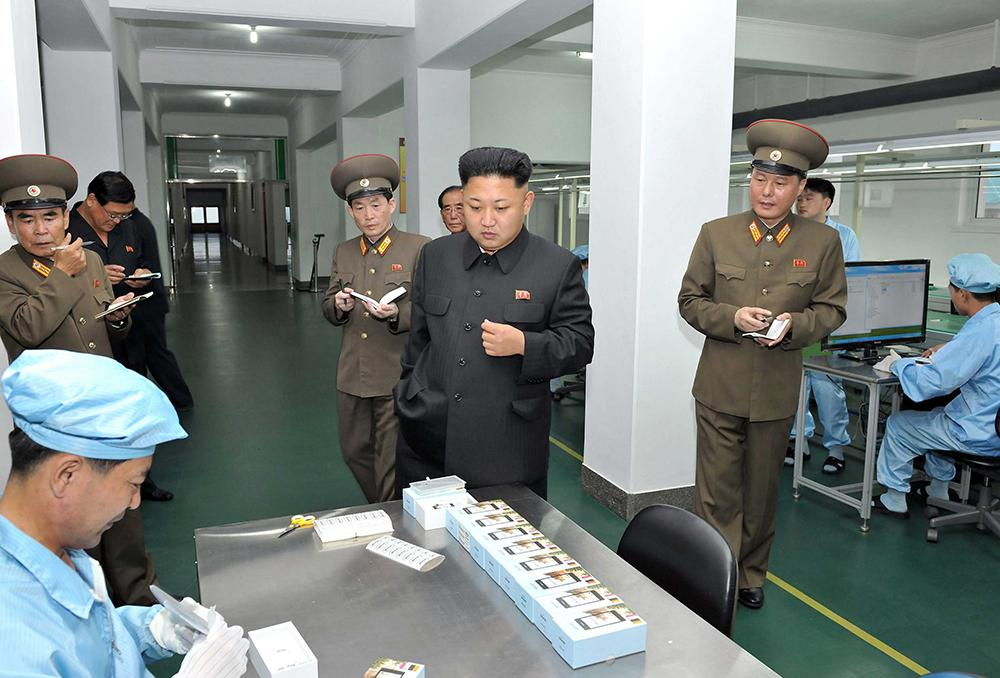 Kim Inspects North Korea Smartphone