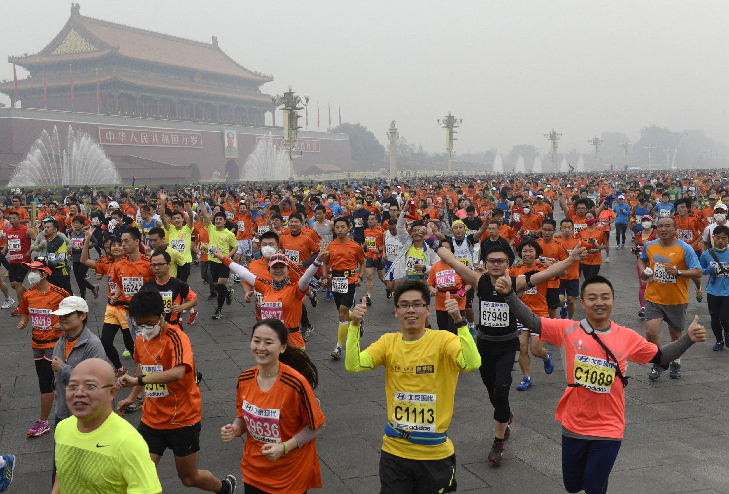 Gm Capital One >> Beijing Marathon 2014: Runners Don Gas Masks As Race Is ...