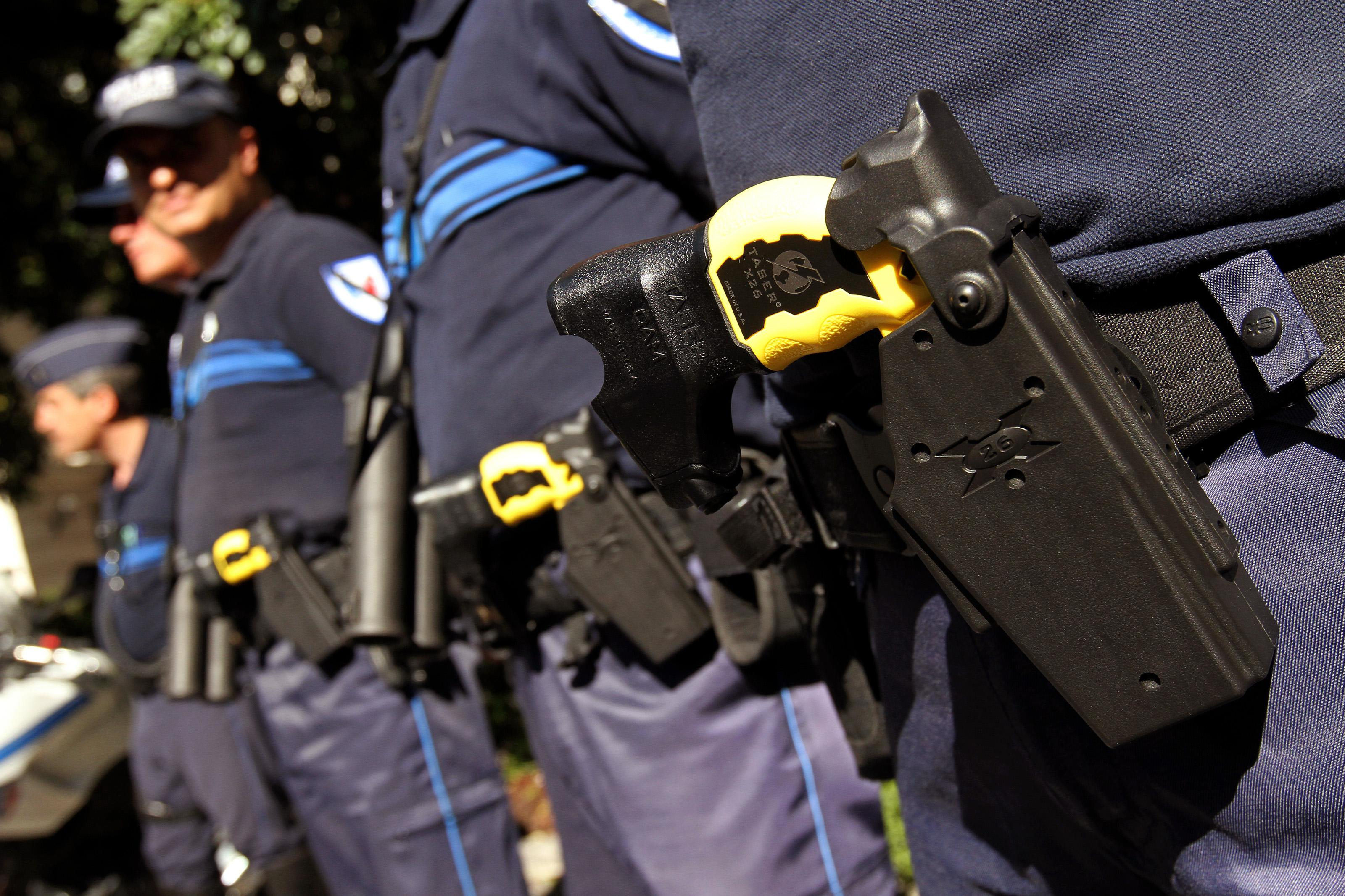 Police pose with Tasers