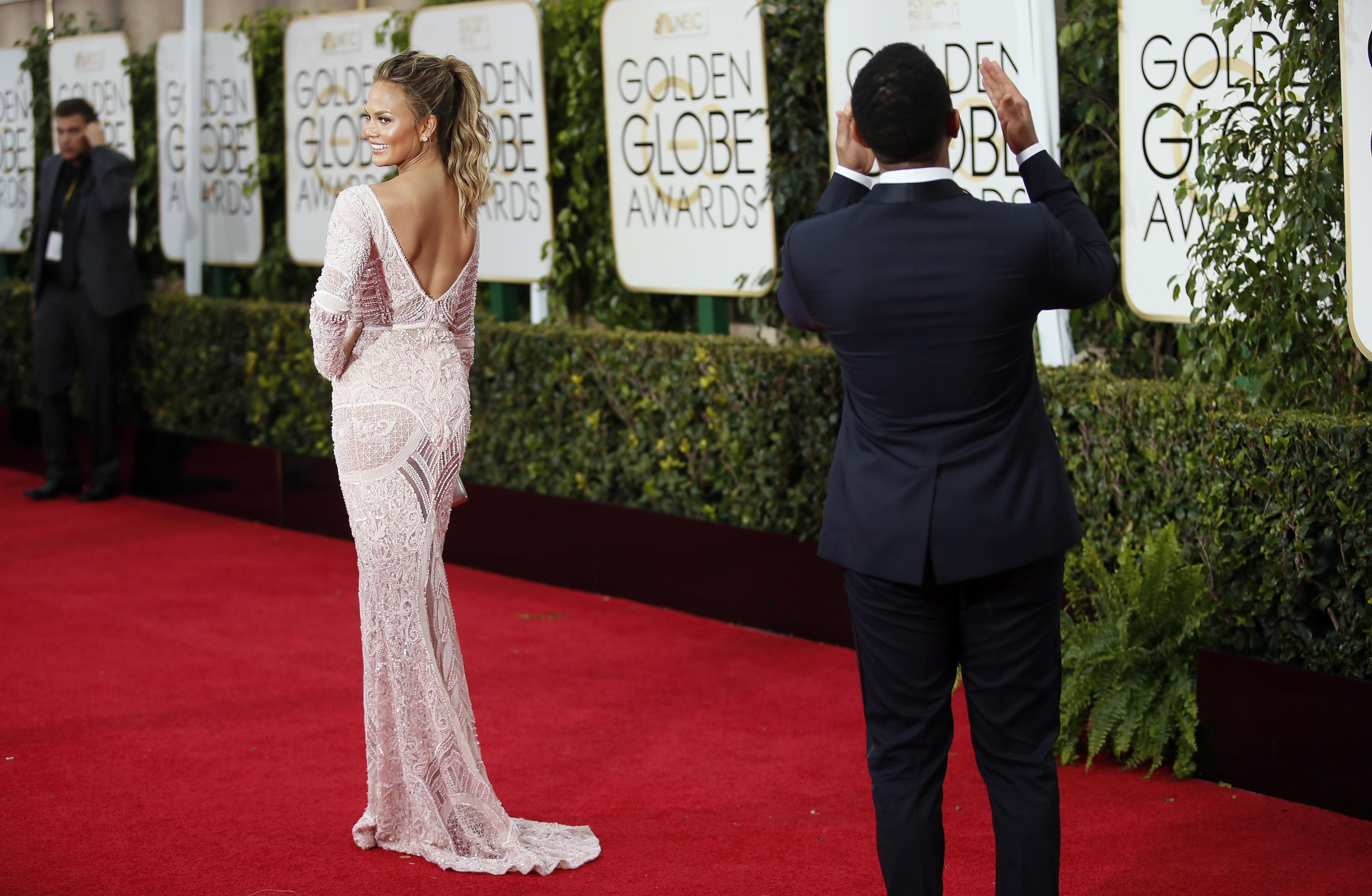 ac80e2ce179 BEST DRESSED  Chrissy Teigen looked stunning in a soft pink Zuhair Murad  gown. The model was accompanied by her husband