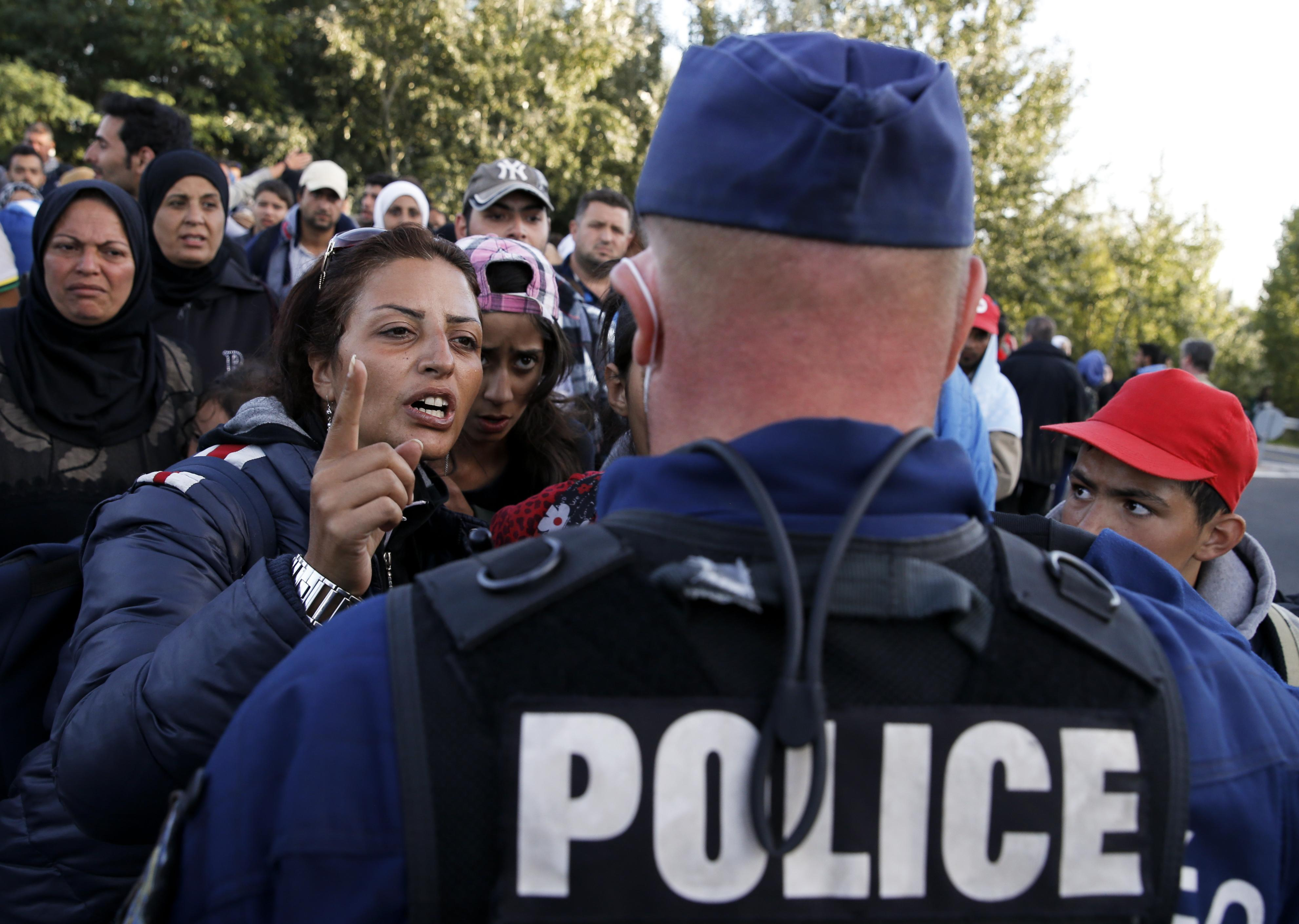 Hungarian police officer, refugees