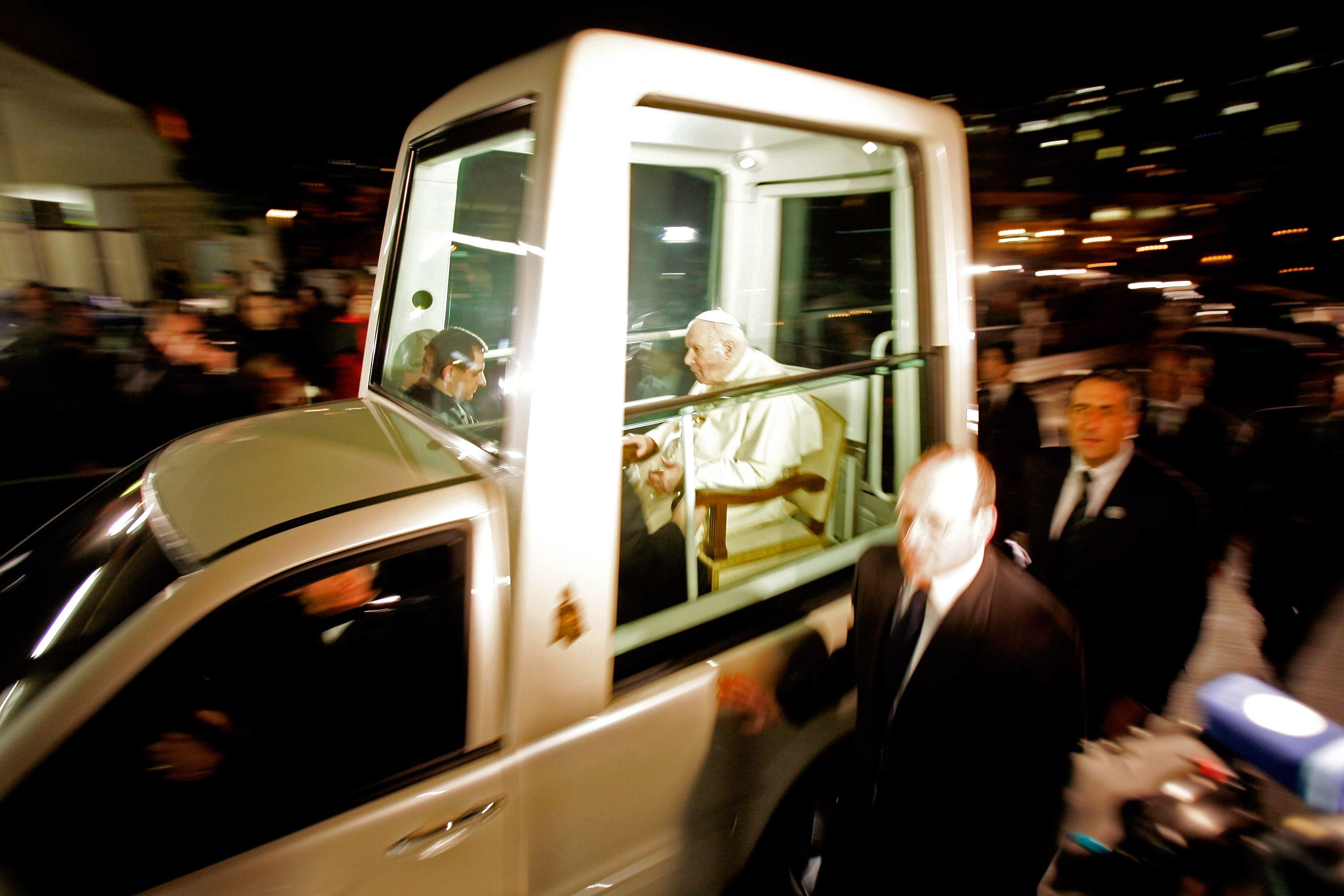 Pope John Paul cruising in Popemobile